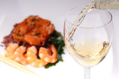 Pouring white wine and background Stock Photos
