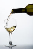 Pouring white wine Royalty Free Stock Image