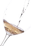 Pouring white wine in a glass Royalty Free Stock Photos
