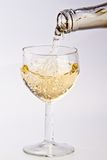 Pouring white wine into a glass Stock Photography