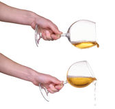 Pouring white wine from glass with hand, wine, splash, jet isolated on white Stock Photography