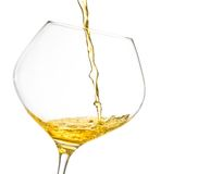 Pouring white wine into a glass with space for text. Pouring white wine into a glass on white background with space for text Royalty Free Stock Image