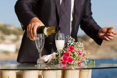 Pouring white wine into glasses Stock Photos