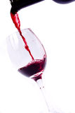 Pouring wine. Isolated on white Royalty Free Stock Photography