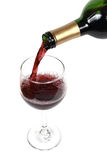 Pouring wine. Wine pouring into a glass Stock Photo