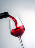 Pouring wine Royalty Free Stock Image