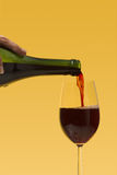 Pouring wine Stock Image