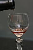 Pouring Wine. Port wine being poured into crystal glass Royalty Free Stock Photo