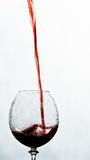 Pouring wine. Pouring a glass of fine red wine Stock Photo
