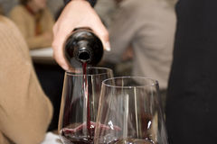 Pouring wine. I went to eat and i saw great moment Stock Photography
