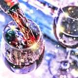 Pouring wine. Christmas wine. Christmas, falling snow, golden snowflakes. New Year. Close up royalty free stock photos