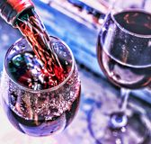 Pouring wine. Christmas wine. Christmas, falling snow, golden snowflakes. New Year. Top veiw royalty free stock photography