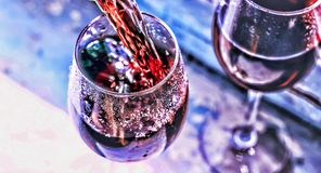 Pouring wine. Christmas wine. Christmas, falling snow, golden snowflakes. New Year. Top veiw stock image