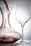 Pouring wine into decanter Royalty Free Stock Image