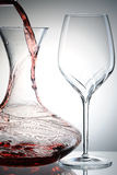 Pouring wine into decanter Royalty Free Stock Photography