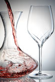 Pouring wine into decanter Stock Image