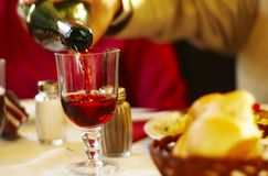 Pouring Wine With Dinner Stock Photography