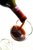 Pouring wine into a glass. Red wine being poured into a wine glass Stock Image