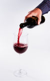 Pouring wine in glass Royalty Free Stock Photos
