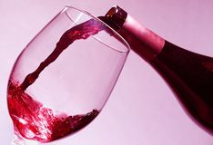 Pouring wine into a glass Royalty Free Stock Photos