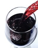 Pouring wine into a glass Royalty Free Stock Images