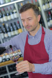 Pouring wine into glass Royalty Free Stock Images