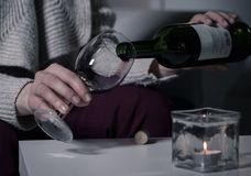 Pouring wine into a glass Royalty Free Stock Image