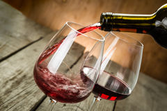 Pouring wine in a glass. Copy space stock image
