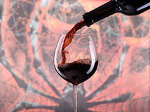 Pouring wine into the glass Royalty Free Stock Images
