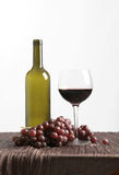 Pouring wine with grapes stock image