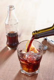 Pouring wine into kalimotxo mixture glass Stock Images