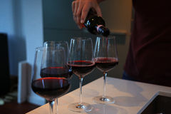 Pouring wine. Man pouring wine in glasses Royalty Free Stock Photos
