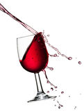 Pouring wine. Pouring red wine with droplets, isolated on a white background Royalty Free Stock Images