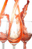 Pouring wine. Pouring red wine in to wine glass Stock Images