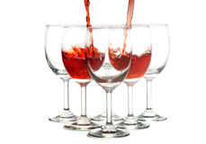 Pouring wine. Pouring red wine in to wine glass Stock Photo