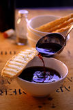 Pouring wine soup with toasted bread Stock Photo