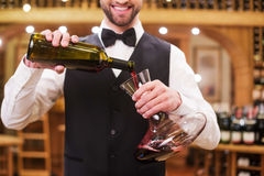 Pouring wine to decanter. Royalty Free Stock Images