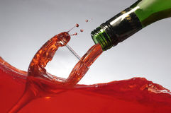 Pouring wine on wine Stock Photo