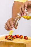 Pouring yellow palm oil Stock Images