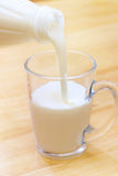 Pouring Yoghurt Into A Glass Stock Photos