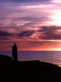 Pourpre de coucher du soleil de couples Photo libre de droits