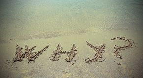 Pourquoi sur le sable de plage photo stock