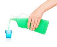 Pours hand cleanser. On an isolated white background Royalty Free Stock Photos