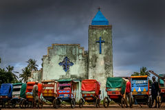 Pousse pousse in front of a church Royalty Free Stock Photo