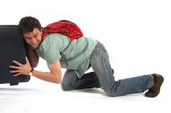 Poussez le valise Photographie stock libre de droits