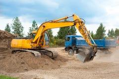 Poussière abrasive de creusement d'excavatrice Image stock