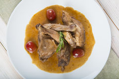 Poussin with grapes sauce Stock Photography