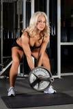 Poussoir de poids femelle Image stock