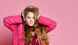 Pout girl in fur headphones stock photos