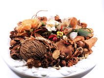 Pout pourri with flowers and dry fruits Stock Photography